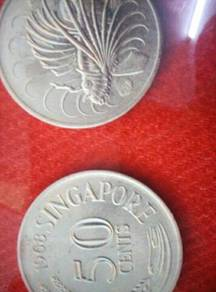 Old Singapore lionfish coins