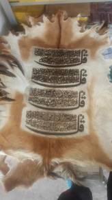 Kulit kambing berserta ayat suci alquran