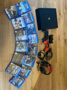 Excellent PS4 Pro With 14 Games and 2 Controllers