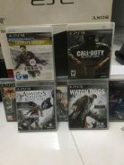 PS3 slim with 7 games and 2control