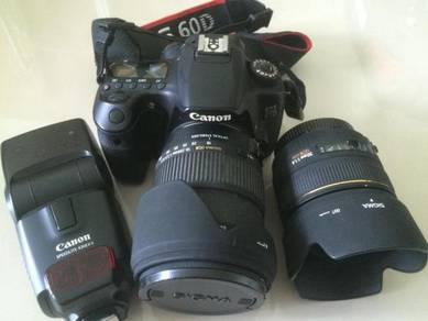 Canon 60D with 2 Sigma Lens and Flashlight