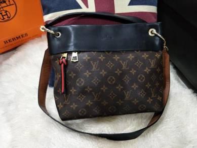 Louis Vuitton Sling Handbag