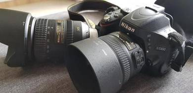Nikon D5100 with 18-20MM + 50mm Lens